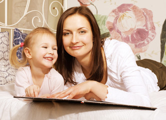 Portrait of mother and daughter at home