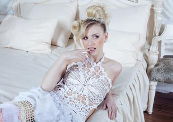 beauty blond bride in luxury white interiors