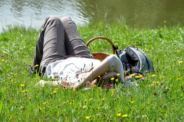 Woman on a meadow at the lake