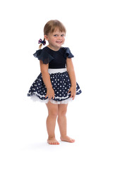 Little girl in a polka dot dress in studio