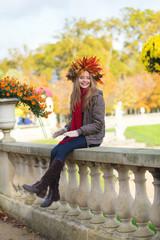 Beautiful girl in colorful autumn wreath