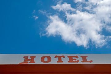 Hotel sign, text at building facade wall