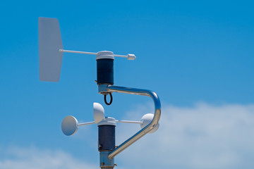 Anemometer, blue sky with clouds as background