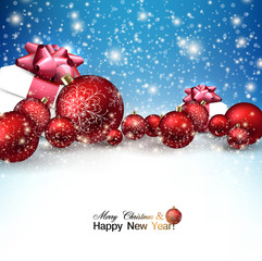 Beautiful Christmas red balls and gifts on snow.  Red Xmas baubl