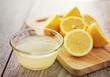 Leinwandbild Motiv freshly squeezed lemon juice in small bowl