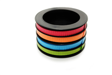 Colorful Ribbons on a Black Spool Over White