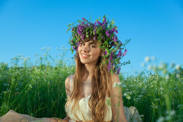 Young girl in a field of flowers.