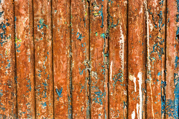 Rusty wall with exfoliated paint