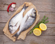 canvas print picture - Fresh dorado fish cooking with spices and condiments