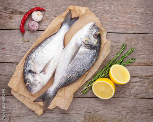 canvas print picture Fresh dorado fish cooking with spices and condiments