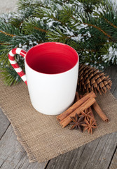 Empty cup for mulled wine, spices and fir tree