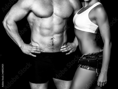 canvas print picture Strong woman and man against a black background