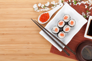 Red caviar, sushi set, sakura branch and chopsticks