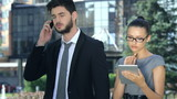 Business couple gets good performance and happily discussing