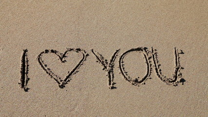 I Love you written in the sand being washed away