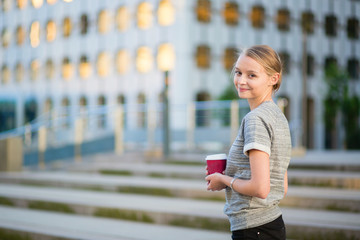 Young business woman drinking coffee outdoors