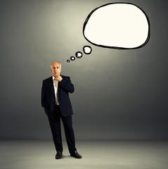man in formal wear with speech balloon