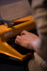 Female hands typing typewriter