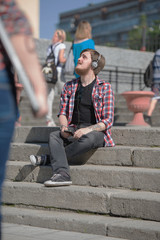 Hipster listening music city