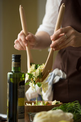 Female hands cooking vegetables salad