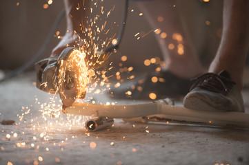Builder plumber using grinder machine