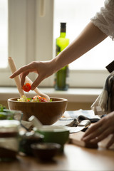 Female hands cooking vegetables salad