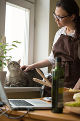 Woman Cooking Cuddling Cat