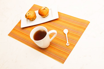 Vanilla with chocolate chips Muffins with a cup of tea