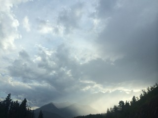 rocky mountains with cloudy sky