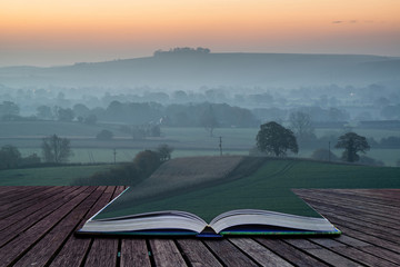 Book concept Stunning sunrise over fog layers in countryside lan