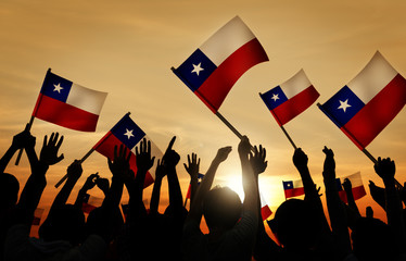 Group of People Holding Chile Flag in Back Lit