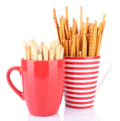 Sticks in red cups on white background isolated