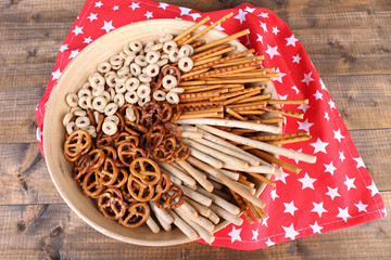Dry breakfast, sticks and biscuits in a big wooden round bowl