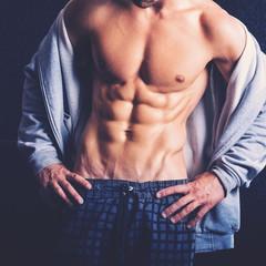 Fit young man abdomen closeup