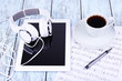 Tablet, cup of coffee printed music and earphones