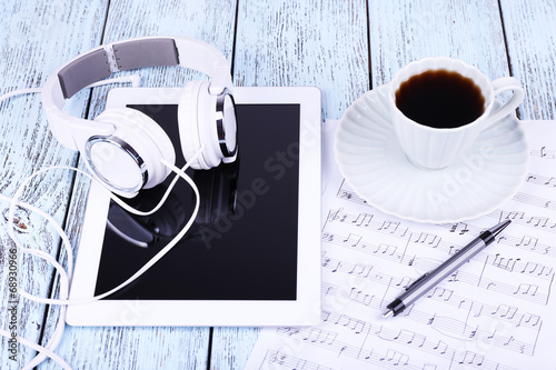 canvas print picture Tablet, cup of coffee printed music and earphones