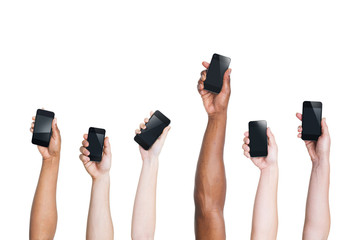 Arms Raising Smartphones and One Standing Out