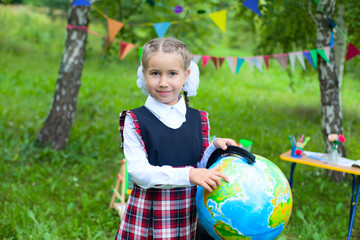 Happy schoolgirl child kid hold globe point out North America