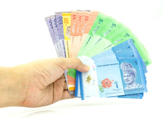 Hand holding lots of Malaysia Ringgit Currency Bank Notes