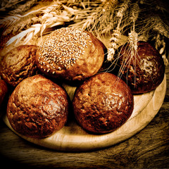 Bread with wheat in vintage style