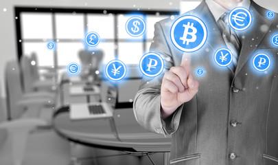 Choosing bitcoins, businessman pressing touch screen button.