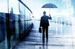 Depressed Businessman Standing with an Umbrella