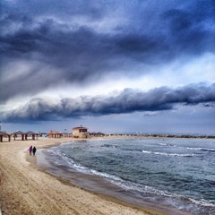 dramatic storm clouds at beach