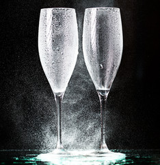 champagne glasses on black spray