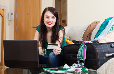 woman reserving hotel or ticket at internet