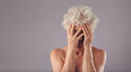 Old woman feeling shy