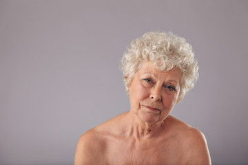 Shirtless old lady looking sad