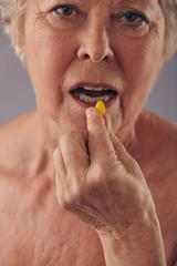 Mature woman talking medicine pill