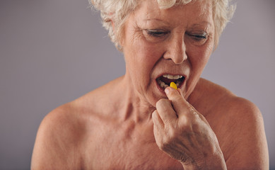 Senior caucasian woman having a pill