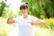 Woman in white t-shirt showing a thumbs up